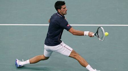 Djokovic cruises, Berdych struggles to make Round 3