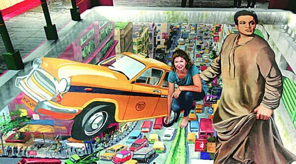 The 3D painting of a Kolkata street at Vivekananda Park  Athletic Club, Haridevpur. Artist Tracy Lee Stum also seen. ( Source: Express photo by Partha paul )