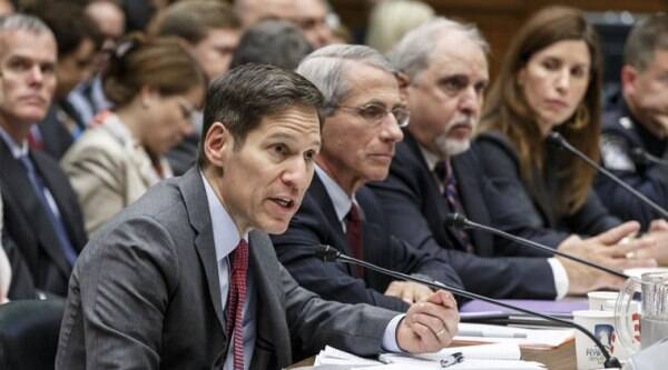 In this Oct. 16, 2014, photo, Dr. Tom Frieden, left, director of the Centers for Disease Control and Prevention, takes questions about Ebola from lawmakers on Capitol Hill at the U.S. Food and Drug Administration, in Washington. (Source: AP)