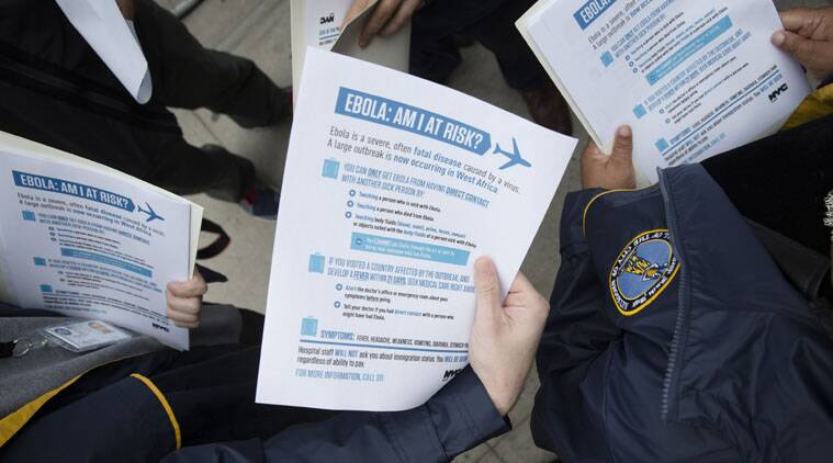 Members of the Brooklyn Borough President's office hand out fliers detailing the risks of Ebola.