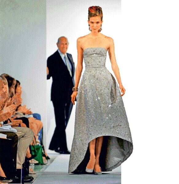 Oscar de la Renta in the background of his Spring Summer 2013 collection at fashion week in New York.