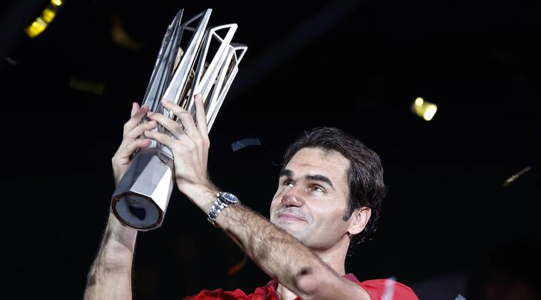 Roger Federer of Switzerland poses with the trophy during the awards ceremony after winning the men's singles final against Gilles Simon of France. (Source: AP)