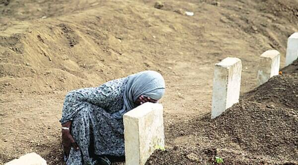 A woman mourns at the grave of her son, a Kurdish fighter who was killed in fighting with ISIS militants in Kobani at a cemetery in Suruc, Turkey.  (AP)