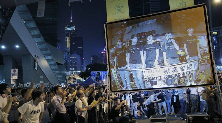Pro-democracy protesters cheer as they listen to student leader's speeches after talks between Hong Kong government officials and students at an occupied area outside the government headquarters in Hong Kong's Admiralty district,Tuesday, Oct. 21, 2014. Hong Kong officials and student leaders held talks Tuesday to try to end pro-democracy protests that have gripped the southern Chinese city for more than three weeks, though chances of success are slim given the vast differences between the two sides. (Source: AP)
