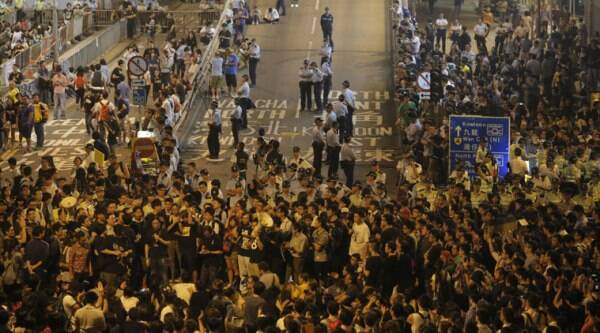 People protest outside a police station after a clash between protesters and police near a occupied area in Hong Kong, Wednesday, Oct. 15, 2014. (Source: AP)