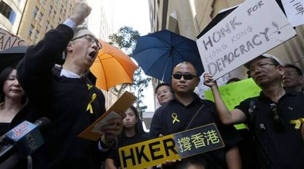 Charles Cheung, left, leads protesters in a chant as they gather outside of the Hong Kong Economic and Trade Office in San Francisco (Source: AP)