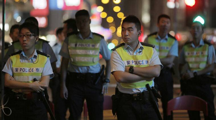 Three journalists were roughed up in Hong Kong after being confronted by pro-government protesters.
