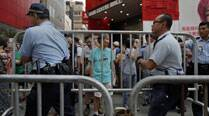 Hong Kong police swoop in on democracy protest site