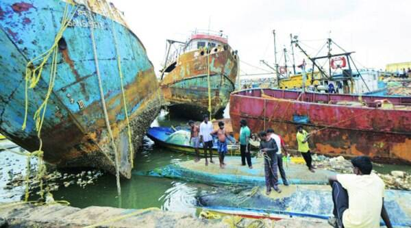 Boats damaged by the cyclone in Visakhapatnam on Monday. (Reuters)
