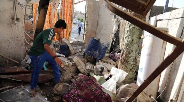An Iraqi inspects damages of his home near the site of the aftermath of a car bomb attack the northern Shiite district of Kazimiyah, in Baghdad, Iraq, Friday, Sept. 19, 2014. A series of bomb and mortar shell attacks in and around Baghdad killed dozens, Iraqi officials said on Thursday, in an assault that underscored the threat posed to the Iraqi capital by marauding Islamic militants that have seized large parts of country. (Source: AP)