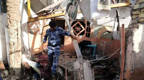 An Iraqi federal policeman inspects the site of the aftermath of a car bomb attack the northern Shiite district of Kazimiyah, in Baghdad, Iraq, Friday, Sept. 19, 2014. A series of bomb and mortar shell attacks in and around Baghdad killed dozens, Iraqi officials said on Thursday, in an assault that underscored the threat posed to the Iraqi capital by marauding Islamic militants that have seized large parts of country. (Source: AP)