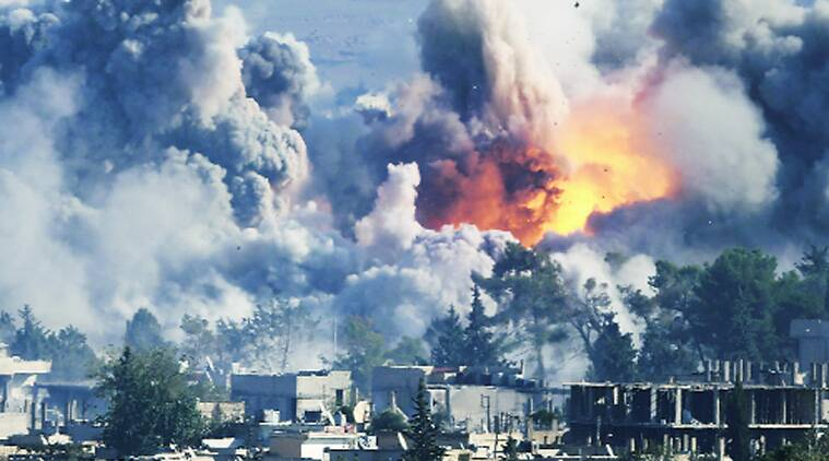 Smoke rises over Kobani after an airstrike, as seen from the Mursitpinar border crossing on the  Turkish-Syrian border, on Saturday. Source: Reuters