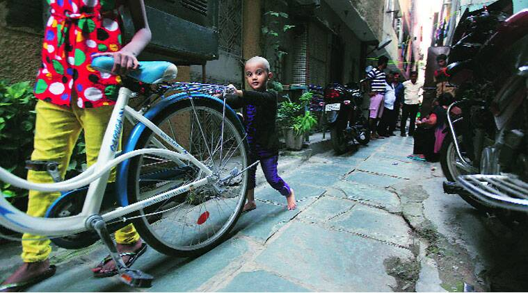 BACK PLAYING: Three-year-old Jahnvi Ahuja plays outside her home on Monday, the day after she was found in West Delhi.(Source: Express photo by Renuka Puri)