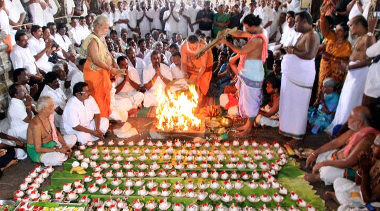 ADMK's Minister for Municipal Administration and Rural Development SP Velumani along with supporters perform a worship in Perur Patteshwaran Temple for the bail and quick release of J Jayalalithaa in Coimbatore on Saturday. (Source: PTI)