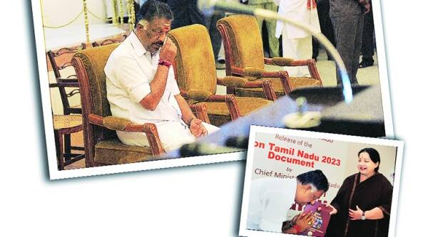 Before taking oath as Chief Minister of Tamil Nadu, O Panneerselvam dabs his eyes , wiping the tears rolling down his cheeks.