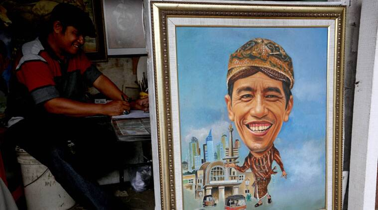 A painting of new Indonesian President Joko Widodo is displayed at his street-side kiosk in Jakarta, Indonesia, Tuesday, Oct. 21, 2014. (Source: AP)