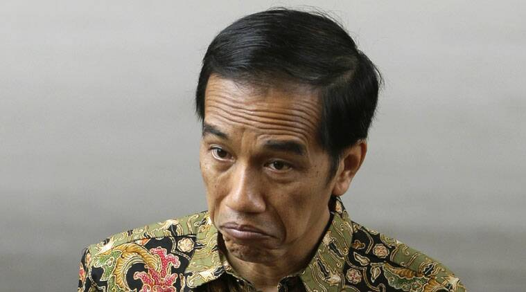 New Indonesian President Joko Widodo prepares for the visit of Papua New Guinea's Prime Minister Peter O'Neill at Merdeka Palace in Jakarta, Indonesia, Tuesday, Oct. 21, 2014. (Source: AP)