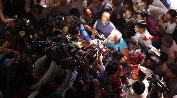 Haryana Chief Minister designate Manohar Lal Khattar surrounded by reporters. (Source: IE photo by Jasbir S.Malhi)