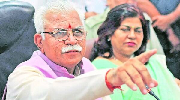 Manohar Lal Khattar gestures while briefing journalists on what a cabinet meeting decided Monday.