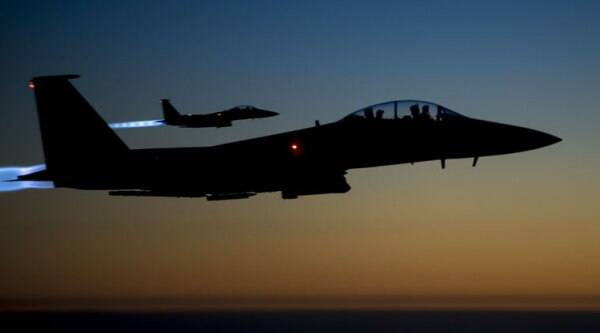 In this Tuesday, Sept. 23, 2014 photo, released by the U.S. Air Force, a pair of U.S. F-15E Strike Eagle flies over northern Iraq, after conducting airstrikes in Syria. U.S.-led coalition warplanes bombed oil installations and other facilities in territory controlled by Islamic State militants in eastern Syria on Friday, Sept. 26, 2014, taking aim for a second consecutive day at a key source of financing that has swelled the extremist group's coffers, activists said. (Source: AP Photo/U.S. Air Force, Matthew Bruch)