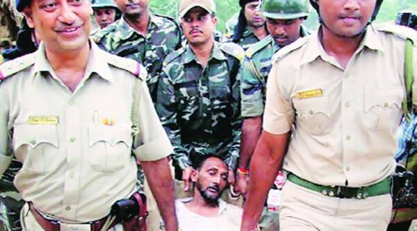 Policemen carry an injured villager after the clash at Makra village in Birbhum on Monday. (PTI)