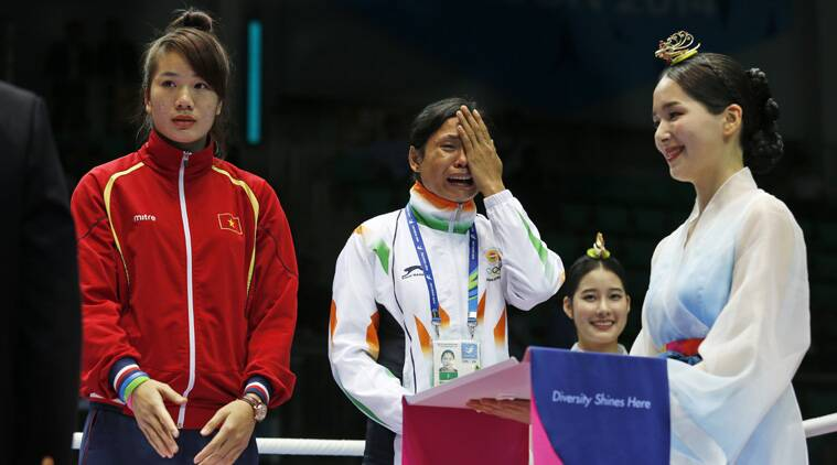 India's La  Sarita Devi cries as she waits for tyhe medal at the podium on Wednesday. (Source: AP)