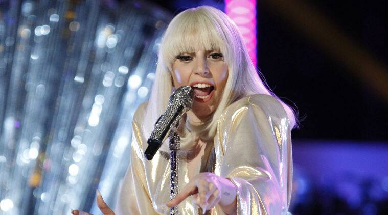Lady Gaga invited fan on stage. (Source: AP)