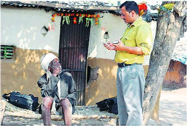 Shailendra Mohan interacts with a villager in Jalgaon.