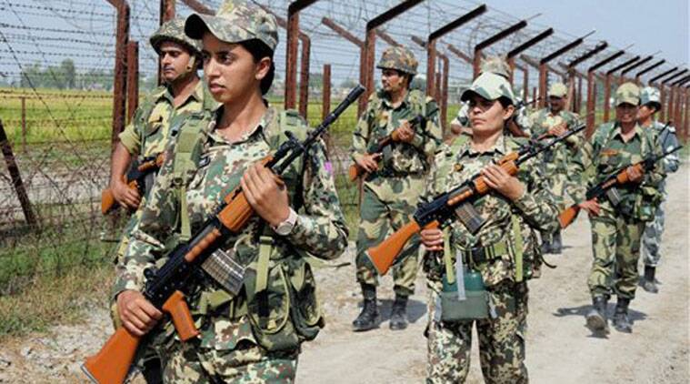 BSF personnel patroling along the fence of Indo-Pak international border at Nueshera Dhalla in Amritsar. (Source: PTI)