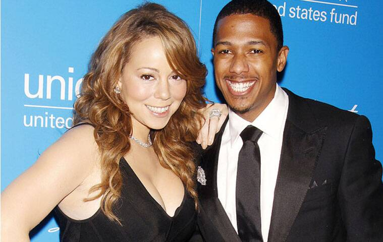 TV host Nick Cannon says he and estranged wife Mariah Carey are dedicated to their family and have not let their split affect the kids.