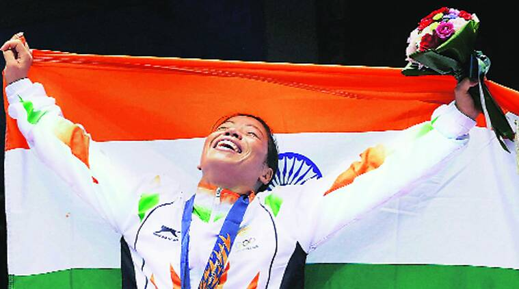 Mary Kom after striking gold in women's flyweight category at Incheon, Wednesday. Source:PTI