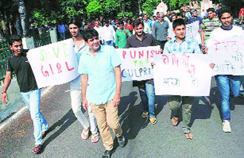 A protest by Meerut College staff. Parents of the girl are both professors at the college.  (Source: Express photo)