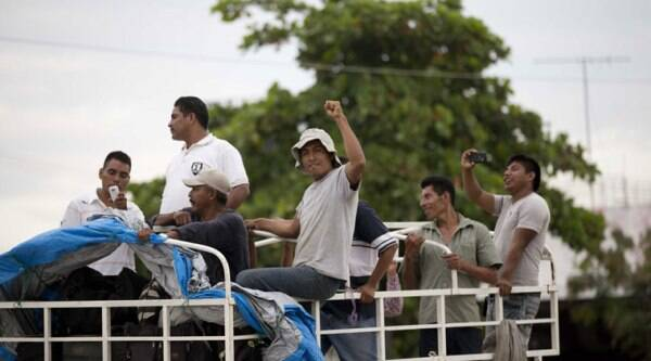 Members of the Community Police arrive to help in the search for the missing students in Iguala, Mexico, Tuesday, Oct. 7, 2014. (Source: AP)
