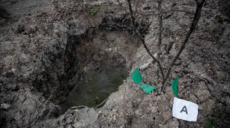 A clandestine grave is seen in Iguala, Mexico, Monday, Oct. 6, 2014. State officials worked Monday to determine whether 28 bodies found in the clandestine graves are of the students who were attacked by local police in Iguala. (Source: AP)
