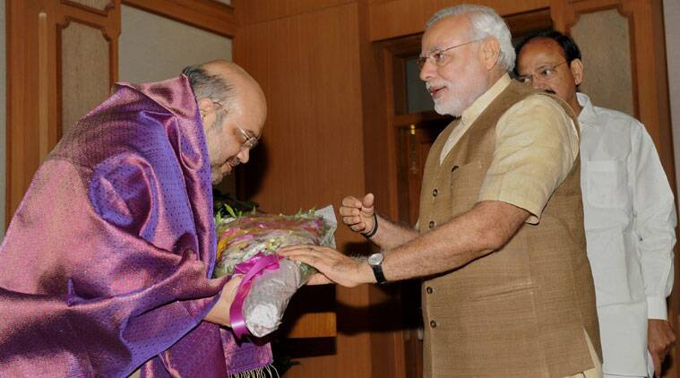 Prime Minister Narendra Modi felicitates BJP President Amit Shah during a High tea hosted by him for NDA MP's at his residence in New Delhi on Sunday. (Source: PTI)