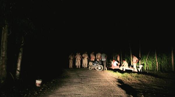 Policemen at the spot where the bodies were found,  in Muzaffarnagar on Monday. Source: Ravi Kanojia