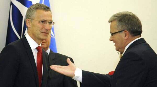 Polish President Bronislaw Komorowski, right, gestures before talks with NATO Secretary General Jens Stoltenberg, left, in Warsaw, Poland, Monday, Oct. 6, 2014. Stoltenberg came to Poland for his first visit abroad after taking over the leadership of the alliance. S(ource: AP)