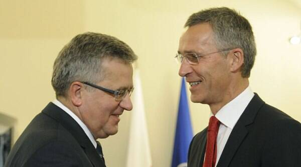 Polish President Bronislaw Komorowski welcomes NATO Secretary General Jens Stoltenberg, right, before talks in Warsaw, Poland, Monday, Oct. 6, 2014. Stoltenberg came to Poland for his first visit abroad after taking over the leadership of the alliance. (Source: AP)