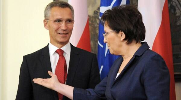 Polish Prime Minister Ewa Kopacz welcomes NATO Secretary General Jens Stoltenberg, left, before talks in Warsaw, Poland, Monday, Oct. 6, 2014. (Source: AP)