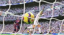 Real Madrid stab three into Barcelona's heart
