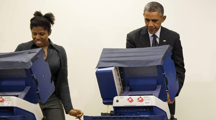 President Barack Obama votes next to Aia Cooper at the Dr. Martin Luther King Community Service Center in Chicago. (Source: AP photo)