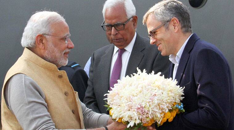 Prime Minister, Narendra Modi being received by Governor N. N. Vohra and Chief Minister Omar Abdullah at Airport in Srinagar on Thursday. (source: PTI)
