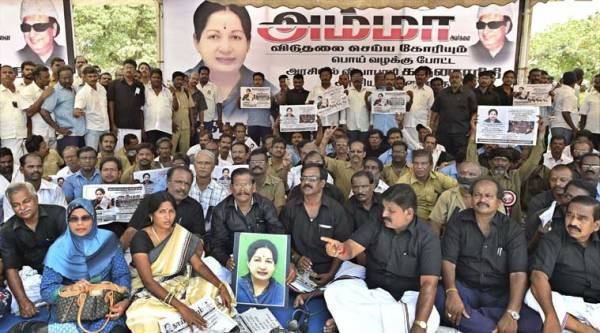 Members of Tamil Nadu State Transport Corporation sit on a hunger strike protesting agaginst AIADMK chief J Jayalalitha's conviction in a disproportionate assets case. (source: PTI)