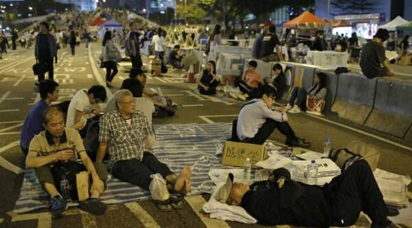 Protesters take a rest during a rally in the occupied areas at Central district in Hong Kong on Thursday. (Source: AP photo)