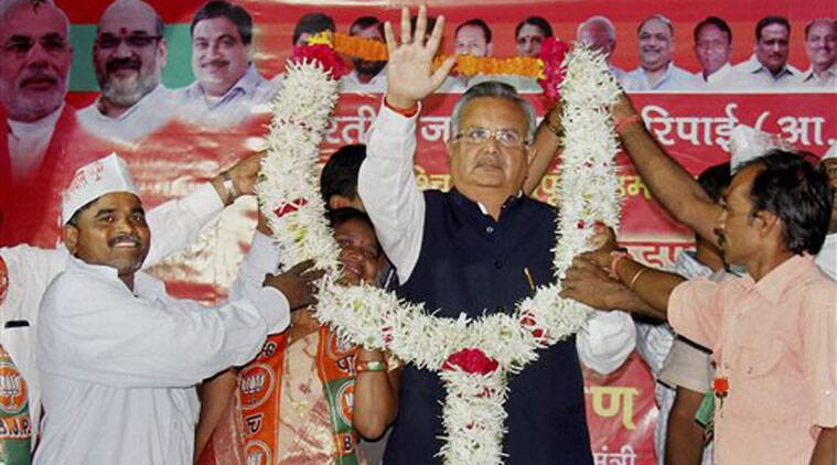 Chatisgarh Chief Minister Raman Singh is garlanded by BJP workers during an election campaign meeting in Nagpur on Sunday night. (Source: PTI)