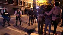 Angry protesters yell at riot police in St. Louis after fatal shooting of blackboy