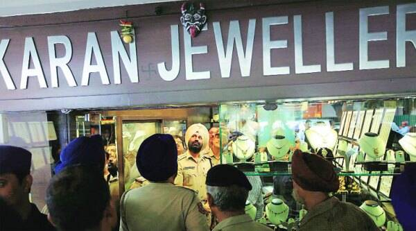 SSP Dr Sukhchain Singh Gill watches a CCTV footage after a robbery at a jewellery shop in Sector 22, Chandigarh, on August 4, 2014. (source: IE photo by Jaipal Singh)