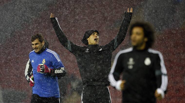 Real's Iker Casillas (L), Cristiano Ronaldo (C) and Marcelo train in torrential conditions at Anfield on Monday. (Source: Reuters)
