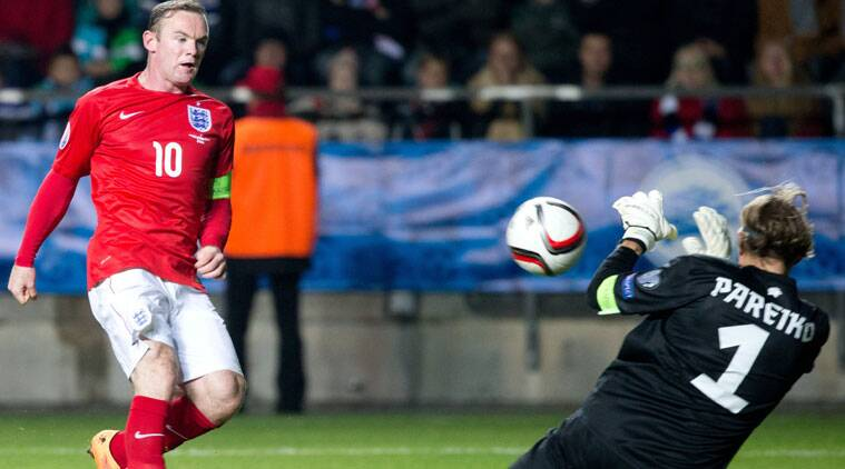 England's Wayne Rooney, left, makes a shot on goal blocked by Estonia's goalkeeper Sergei Pareiko during the Euro 2016 qualifying match. (Source: AP)