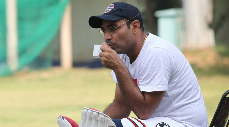 Virender Sehwag warms up with a cup of hot beverage. (IEE phot by Kamleshwar Sharma)